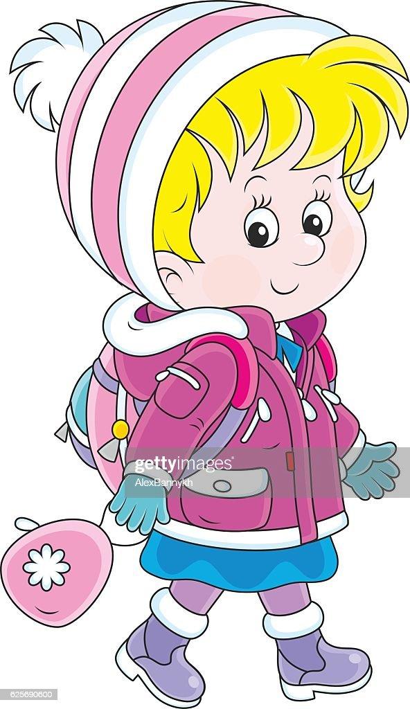 Schoolchild in winter clothes