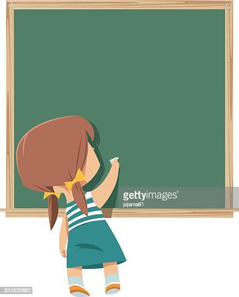 Schoolchild writing on blackboard