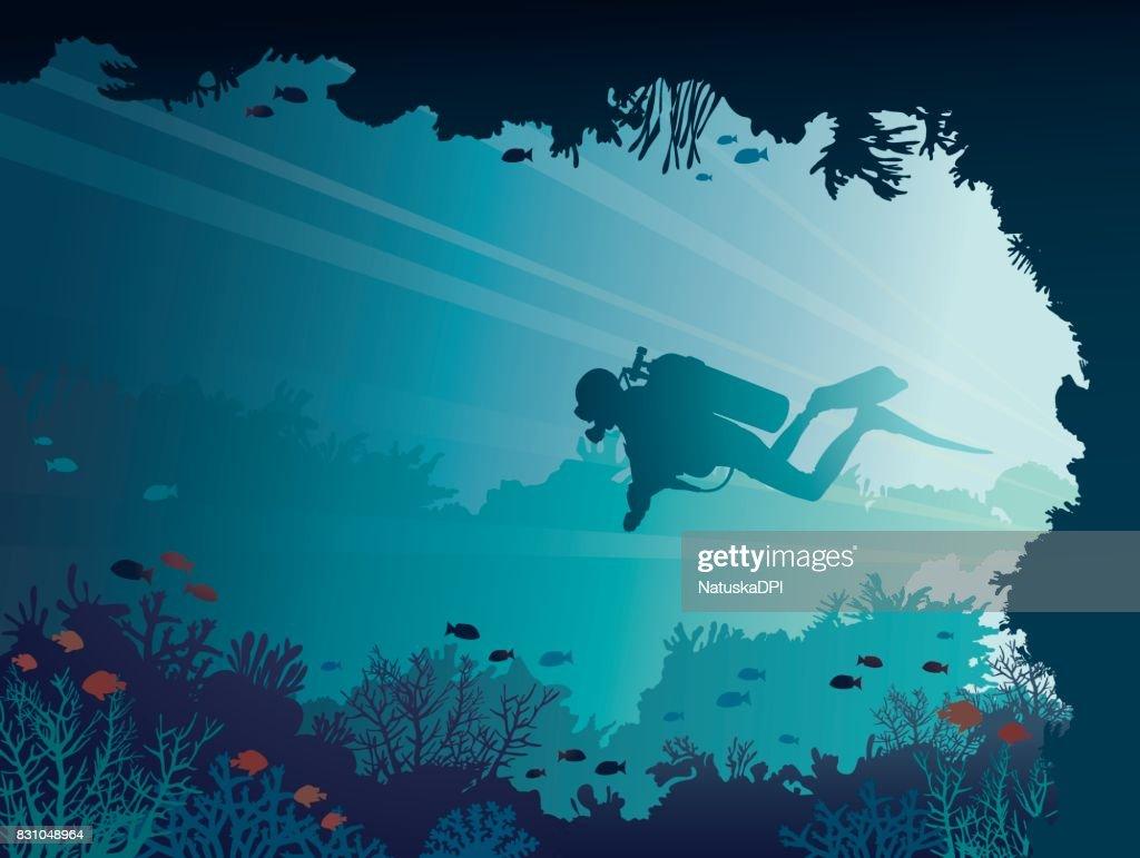Scuba diver, underwater cave, corals, sea