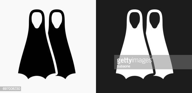scuba diving fins icon on black and white vector backgrounds - diving flipper stock illustrations, clip art, cartoons, & icons