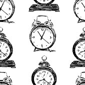 Seamless background of the old alarm clocks