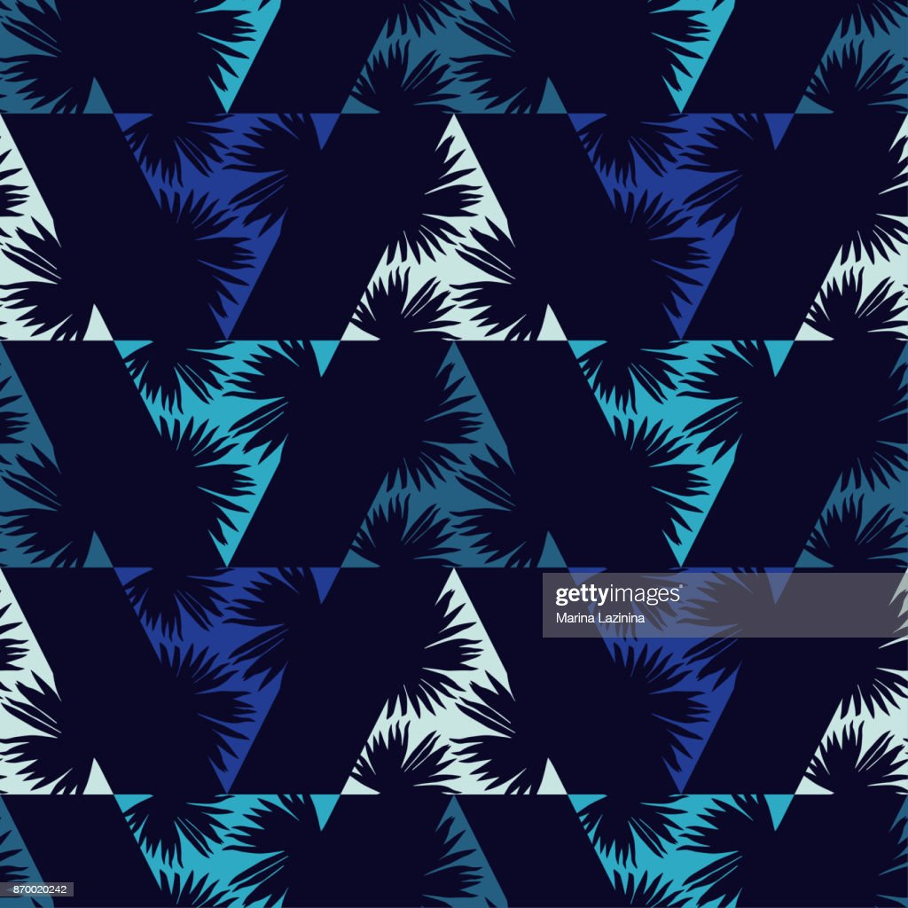 Seamless background with decorative leaves. Palm branch leaves in triangles. Pattern with Palm leaves. Textile rapport.
