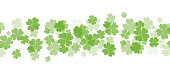 Seamless border with fourleaf clover and sparkle. St.Patricks Day.
