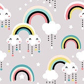 Seamless childish pattern with cute rainbow, stars, clouds.Creative scandinavian kids texture for fabric, wrapping, textile, wallpaper, apparel. Vector illustration