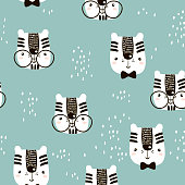 Seamless childish pattern with cute tiger face. Creative nursery background. Perfect for kids design, fabric, wrapping, wallpaper, textile, apparel