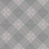 Seamless glen plaid pattern in classic black and white with red overcheck.