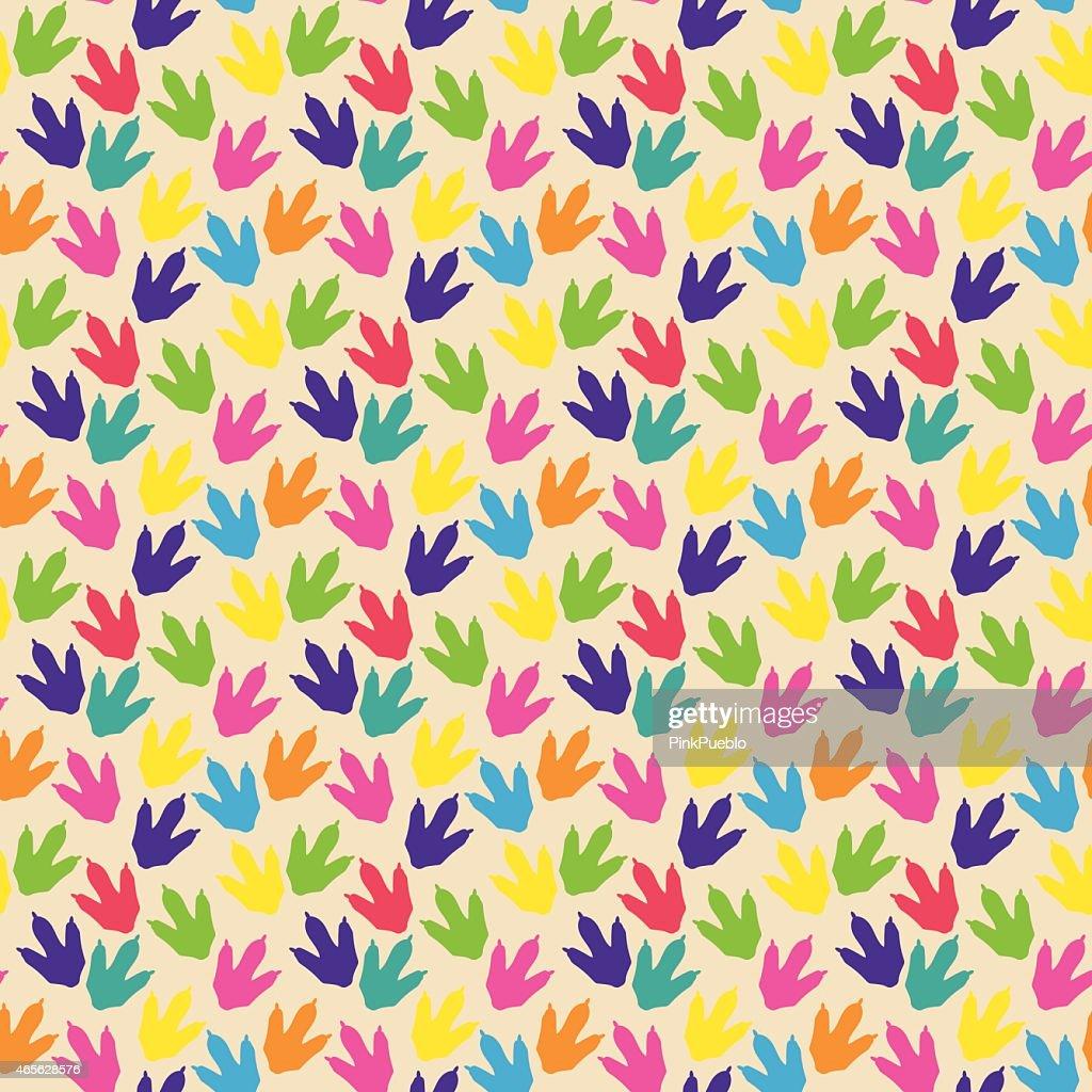 Seamless multicolor dinosaur footprints vector pattern