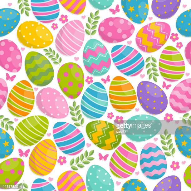 seamless pattern of easter eggs, flowers and butterfly on white background - easter stock illustrations