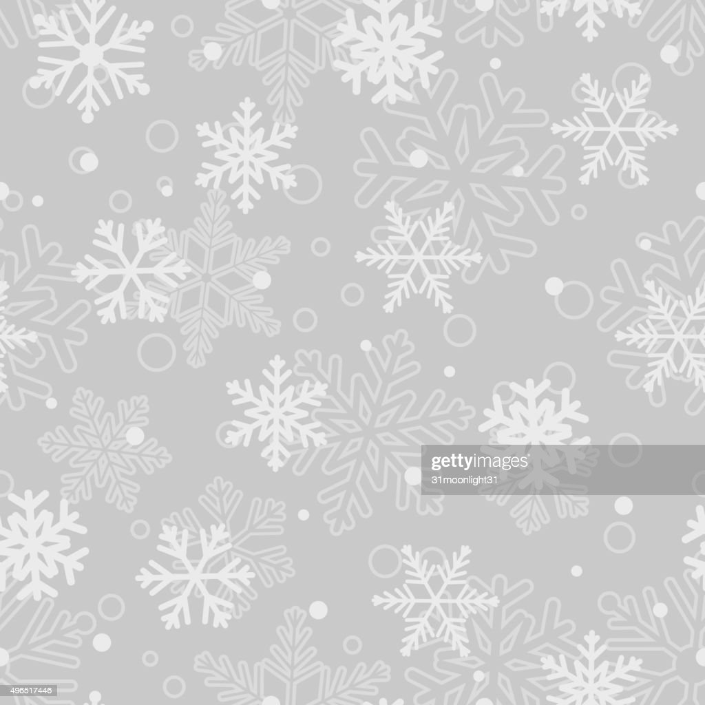 Seamless pattern of snowflakes, white on gray
