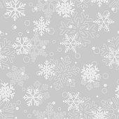 Seamless pattern of snowflakes, white on gray