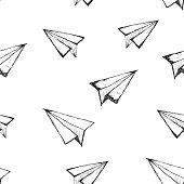 Seamless pattern with a paper airplane on a white background