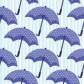 seamless pattern with blue umbrellas on striped background