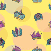 Seamless pattern with bright graceful crowns on a yellow background.