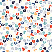 Seamless pattern with colorful skulls