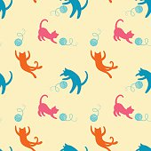Seamless pattern with cute playing kitten.