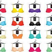 Seamless pattern with different bras on a hanger.