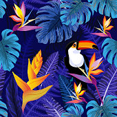 Seamless pattern with flowers and toucan bird