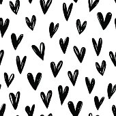 Seamless pattern with hand drawn graphic hearts.