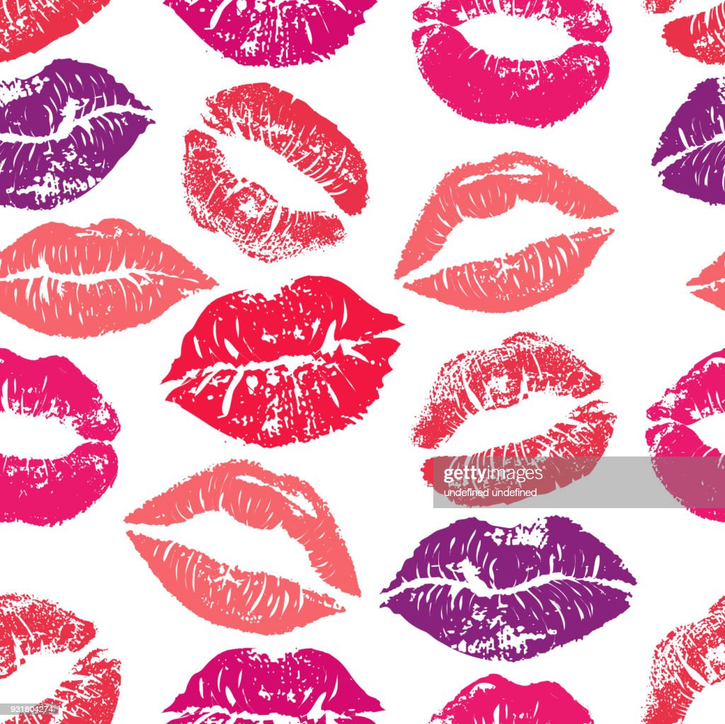 Seamless pattern with lipstick kisses. Colorful lips of red purple and pink shades isolated on a white background.fabric print, wrapping or romantic greeting card design