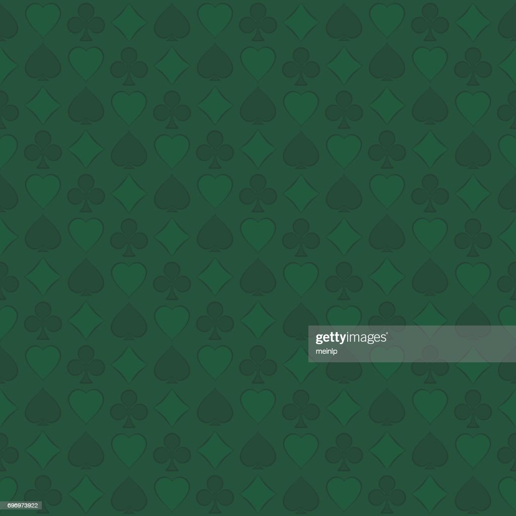 Seamless pattern with playing card suits on green background.
