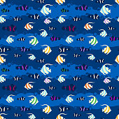 Seamless pattern with tropical fish. Anemone fish and  pennant fish background