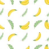 Seamless pattern with tropical palm leaves and bananas