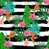 Seamless summer tropical pattern with exotic flowers and leaves