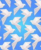 Seamless texture with white origami  doves  on a blue background.
