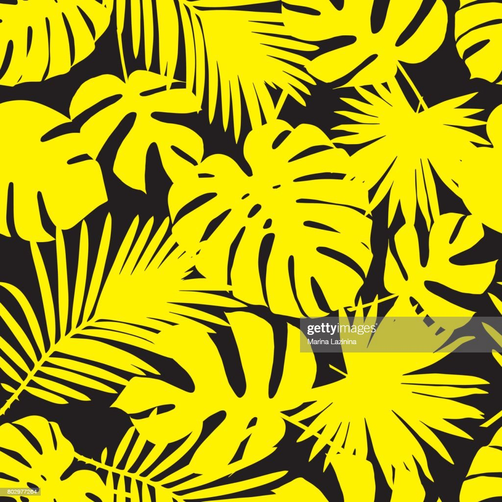 seamless vector background with yellow leaves of palm trees on a