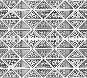 Seamless vector pattern. Geometrical background with hand drawn decorative tribal elements in black and white colors. Print with ethnic, folk, traditional motifs. Graphic vector illustration.