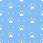 Seamless vector pattern of dog paw and bown. Pawprints