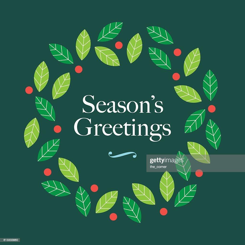 Season Greetings card with wreath mistletoe and logo.