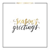Seasons greetings gold text with black splashes