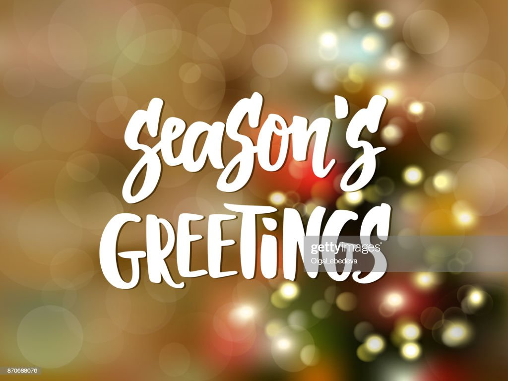 Seasons greetings text hand drawn lettering holiday greetings quote seasons greetings text hand drawn lettering holiday greetings quote blurred background with christmas m4hsunfo