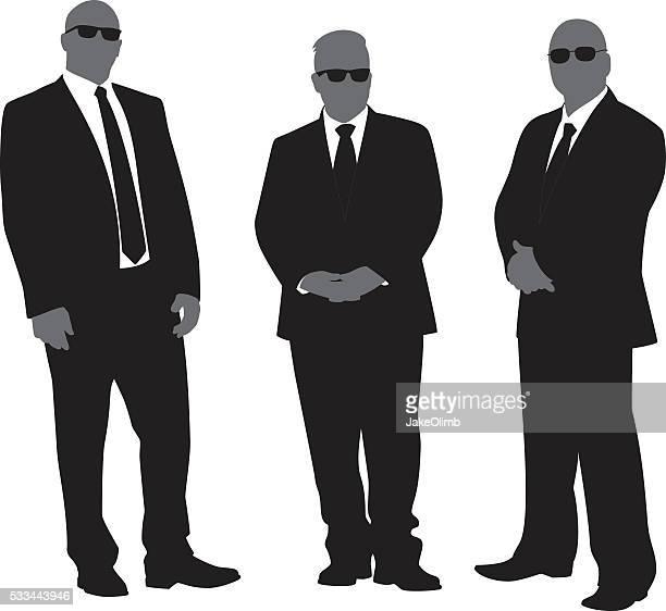 Sicherheit Männer in Anzügen Silhouetten