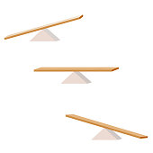 Seesaw. set of three items. wooden plank balancing on a wooden triangle.