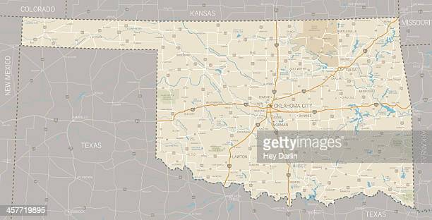 a segmented map of oklahoma next to texas - next stock illustrations