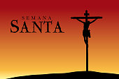 Semana Santa - Holy Week in Spanish language - Silhouette of the crucifixion of Christ at sunset