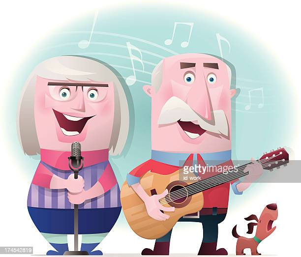senior couple playing guitar and singing