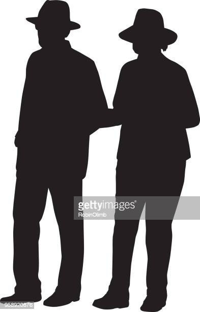 Senior Couple Walking Arm In Arm Silhouette