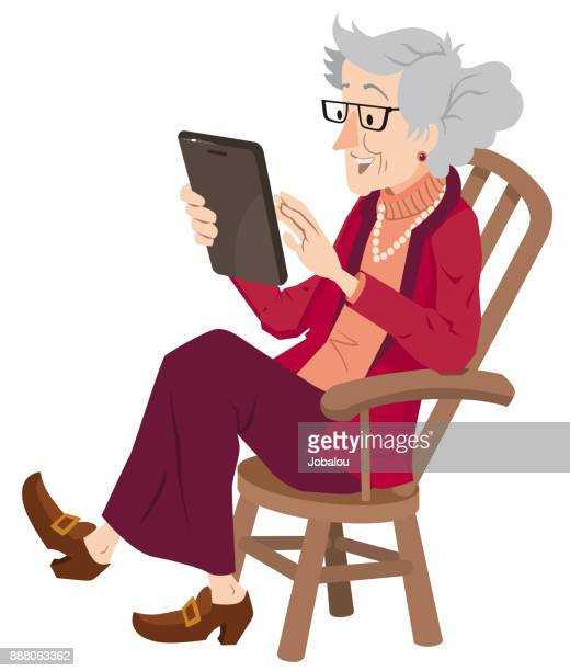 senior lady using digital tablet - one senior woman only stock illustrations