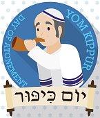 Senior Man Blowing a Shofar behind Scrolls for Yom Kippur