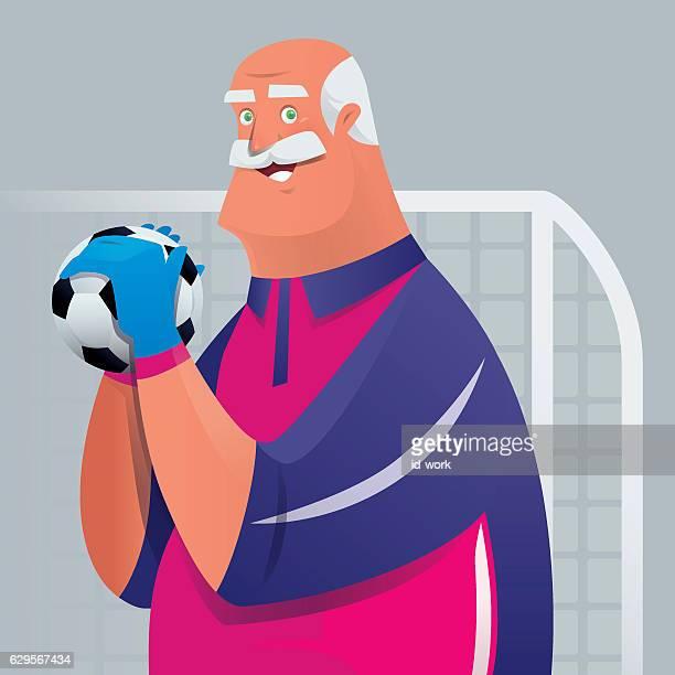 senior man holding soccer ball