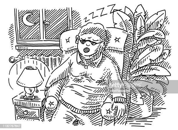 Senior Woman schläft im Sessel