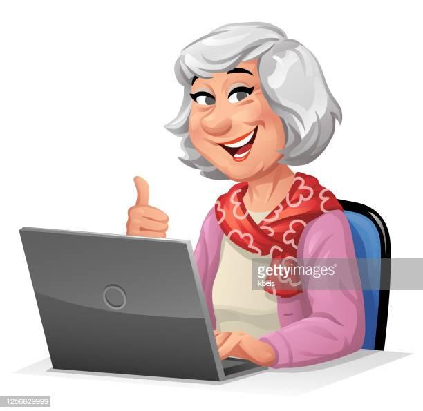 senior woman using laptop - senior citizen clipart stock illustrations