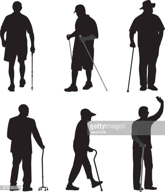 seniors walking with canes silhouettes - walking cane stock illustrations