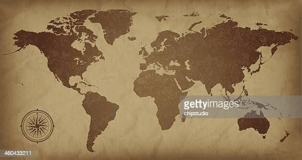 a sepia colored vintage world map, with a compass detail  - ancient stock illustrations