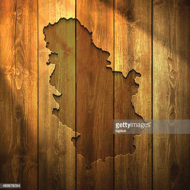 Serbia Map on lit Wooden Background