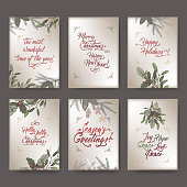 Set of 6 A4 format Christmas color greeting cards with mistletoe, pine branches and holiday brush lettering.