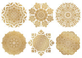 Set of 6 hand-drawn gold Arabic mandala on white background.